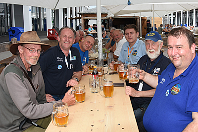 L-R ?, EI5GM, G0VJG/FW5JG, M0SDV, DJ7JC & EI9FBB enjoying some beers at Friedrichschafen 2019 (Photo by G3TXF)